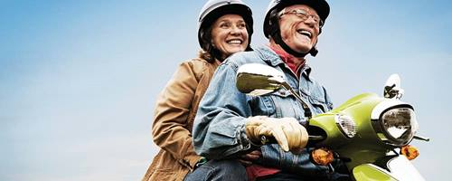 Older Adult Couple on moped