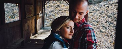 Couple embracing in a covered bridge
