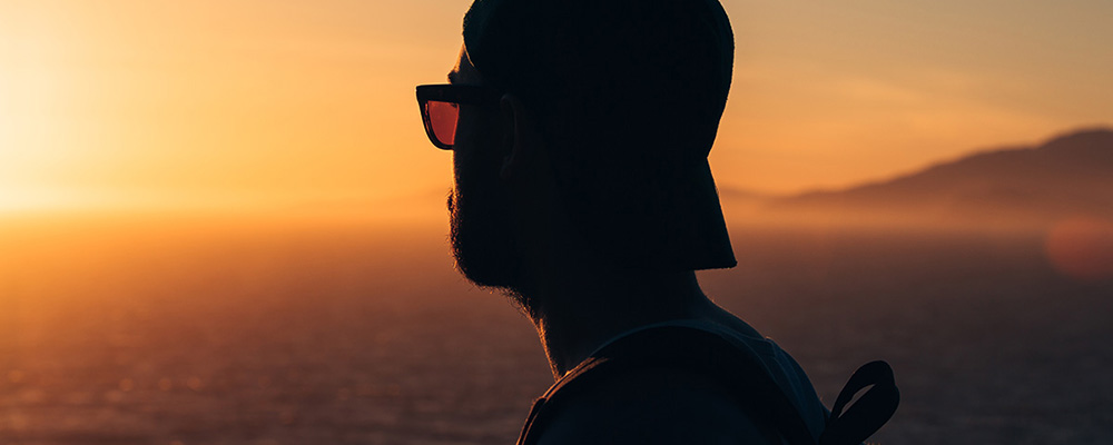 Young Man Looking at Sunset