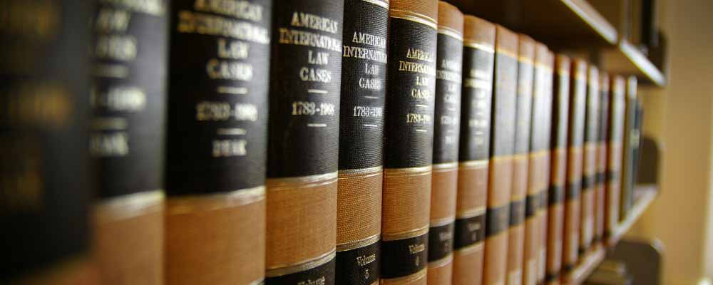Law books lined up on shelf