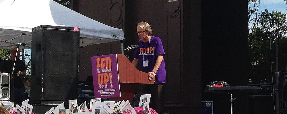 Dr. Marvin Seppala, chief medical officer of Hazelden Betty Ford Foundation, standing at a podium at a Fed Up! rally