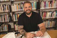Matt Sassman in the Hazelden Betty Ford Graduate School of Addiction Studies library