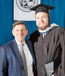 Commencement speaker Michael Botticelli is shown here with 2019 graduate Johnny Solomon